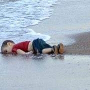 Washed up body of Aylan Kurdi, a Syrian refugee child who drowned during a failed attempt to sail to the Greek island of Kos, at the shore in the coastal town of Bodrum in Turkey on 2 September 2015.