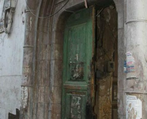 The entrance of the destroyed Abed Palace in Souq Saruja, home of Syria's founding first president, Mohammad Ali al-Abed.