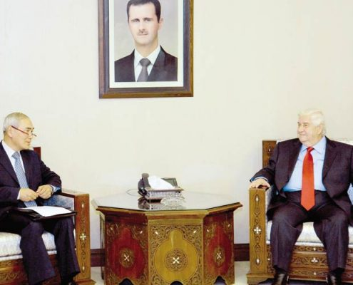 Syrian Foreign Minister Walid Muallem (R) meeting with Chinese Special Envoy for Syria Xie Xiaoyan