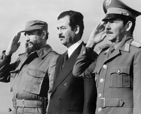 (FILES) This handout photo taken and released by Prensa Latina on January 30, 1979 in Havana, shows Iraqi vice-president Saddam Hussein (C) standing during his visit to Cuba with Cuban President Fidel Castro (L) and Defense minister General Raul Castro. Cuban revolutionary icon Fidel Castro died late on November 25, 2016 in Havana, his brother announced on national television. / AFP PHOTO / PRENSA LATINA / -