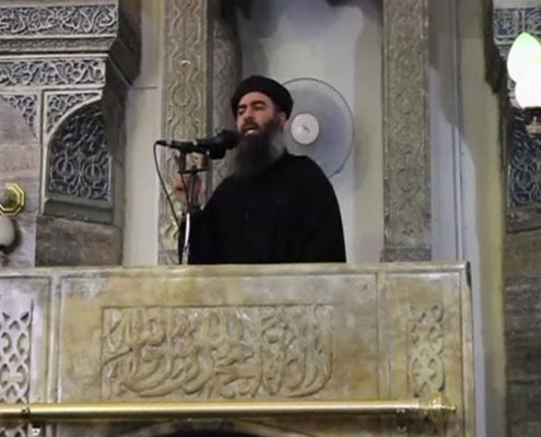 A man purported to be the reclusive leader of the militant Islamic State Abu Bakr al-Baghdadi has made what would be his first public appearance at a mosque in the centre of Iraq's second city, Mosul, according to a video recording posted on the Internet on July 5, 2014, in this still image taken from video. There had previously been reports on social media that Abu Bakr al-Baghdadi would make his first public appearance since his Islamic State in Iraq and the Levant (ISIL) changed its name to the Islamic State and declared him caliph. The Iraqi government denied that the video, which carried Friday's date, was credible. It was also not possible to immediately confirm the authenticity of the recording or the date when it was made. REUTERS/Social Media Website via Reuters TV (IRAQ - Tags: POLITICS) ATTENTION EDITORS - THIS IMAGE HAS BEEN SUPPLIED BY A THIRD PARTY. IT IS DISTRIBUTED, EXACTLY AS RECEIVED BY REUTERS, AS A SERVICE TO CLIENTS. REUTERS IS UNABLE TO INDEPENDENTLY VERIFY THE CONTENT OF THIS VIDEO, WHICH HAS BEEN OBTAINED FROM A SOCIAL MEDIA WEBSITE - RTR3X9AW
